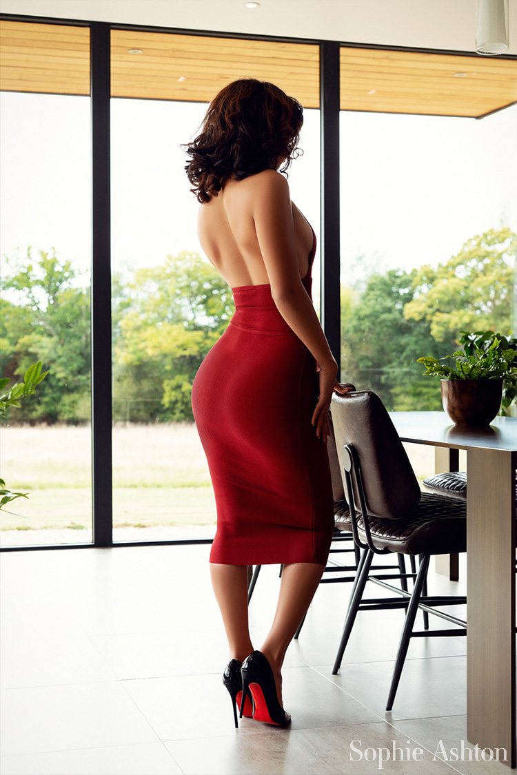 Showing off her big bottom in a very expensive, tight red dress