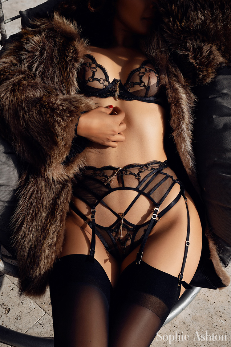 Seductive in black lace, relaxing in her Heathrow Airport hotel