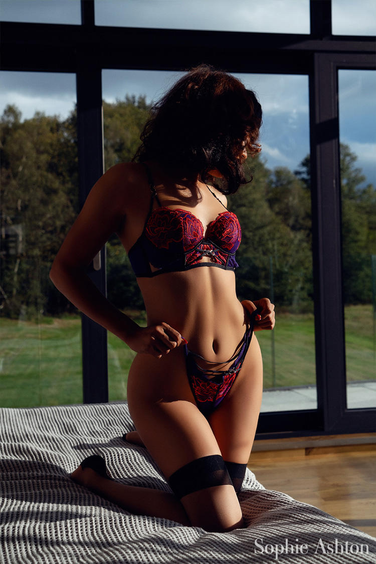 Modelling gorgeous lingerie in the living room of her Midlands home