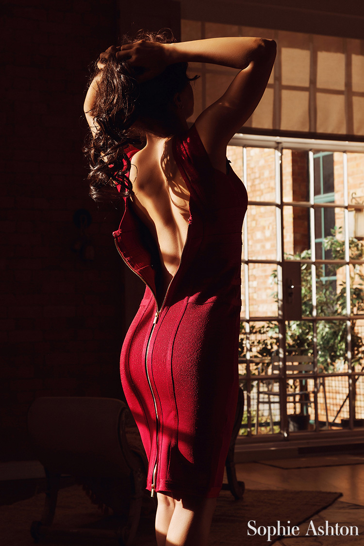 More of upscale companion Sophie Ashton in her tight, red dress.